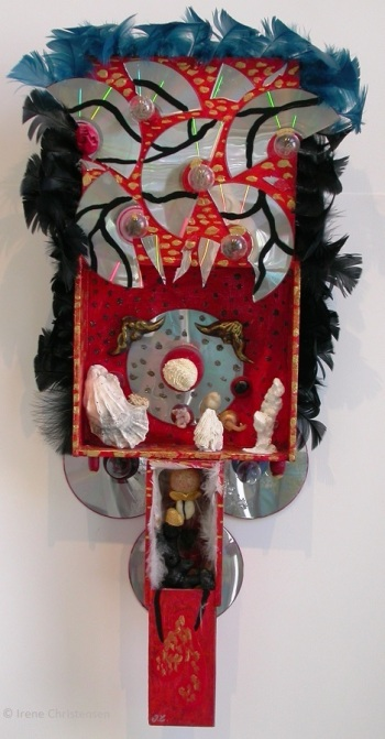 Red Red Raven, 27 by 12 by 4 inches, mixed media box sculpture