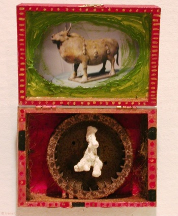 Spinning Continents, 10.5 by 7.25 by 2.5 inches, mixed media box sculpture